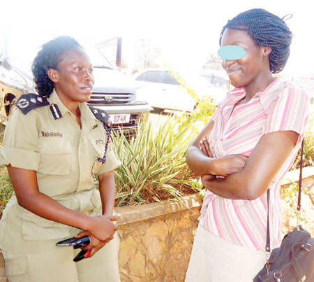 Police spokesperson Judith Nabakooba (left) with Lynn Tino