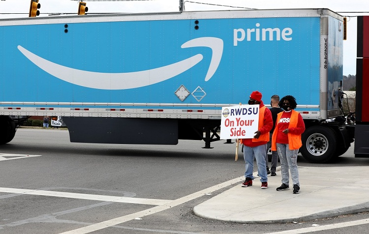 Amazon's profit more than triples as pandemic boom continues