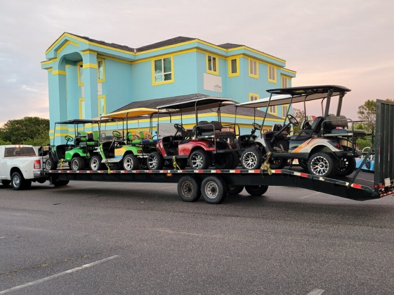 Parked trailer loaded up with new golf carts for the season
