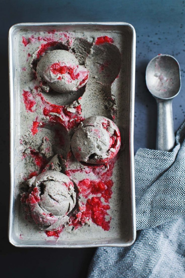 Grey ice cream with bright pink swirls.
