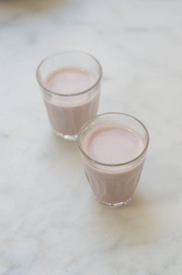Pale pink milk in two glasses.