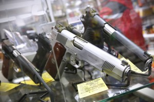A display of 7-round .45 caliber handguns are seen at Coliseum Gun Traders Ltd. in Uniondale, New York January 16, 2013. President Barack Obama proposed a new assault weapons ban and mandatory background checks for all gun buyers on Wednesday as he tried to channel national outrage over the Newtown school massacre into the biggest U.S. gun-control push in decades. REUTERS/Shannon Stapleton (UNITED STATES - Tags: POLITICS CIVIL UNREST SOCIETY) - RTR3CJCM