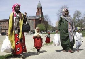 Somali women and their children walk through downtown Lewiston, Maine.