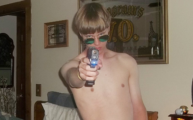 Dylann Roof strikes a pose