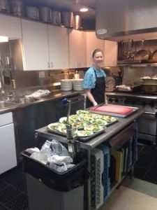 OCCOA Food Service Coordinator Lydia Vandezande gets food ready to go to the seniors.
