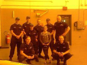 Amanda Galindo with members of the U.S. Coast Guard in Grand Haven.