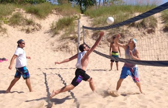 The Cancer and Critical Care Fund organizes fun events, like the beach volleyball tournament during Pentwater Homecoming, to raise money for local people fighting cancer and other serious illnesses.