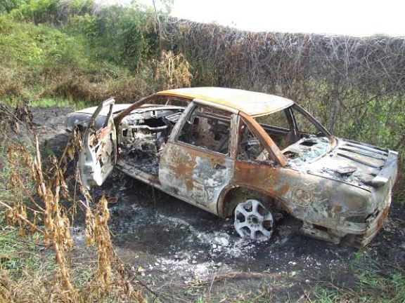 This burned car located in a wooded area near the Hart Dam may be the same car that was stolen from the Oceana County Fairgrounds parking area during the final night of the fair a few weeks ago.
