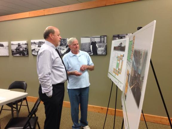 Oceana County Medical Care Facility Administrator Greg Wilson, left, and Hart Mayor Harold Schaner look over architect drawings during a public hearing in the Hart City Hall Community Center Thursday that focused on the facility's proposed $11.7 million expansion.