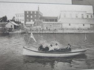 This photo of a boat on Pentwater Lake that resembles the Katahdin is displayed on a historical sign board located on the north side of the channel into Pentwater Harbor.