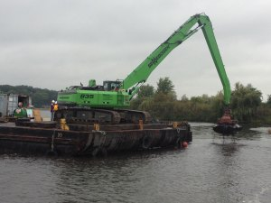 A construction crew removes contaminated sediment from White Lake.