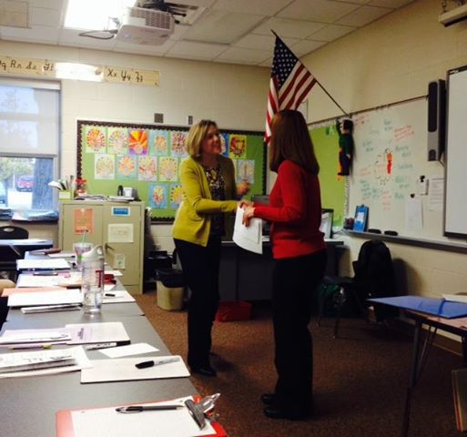 Hart's Spitler Elementary School Principal Amy Taranko, at left, is congratulated for her regional award.