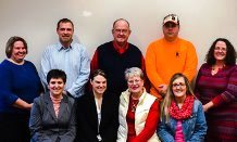 Presentation to Shelby Public School K-5 and middle/high school choir programs, include (L to R), Stacey Scouten, Dee Markiewicz Carter, Denise Markiewicz, Nancy Blount; second row, Fran Schamber, Andy Carter, Bob Markiewicz, Rob Markiewicz, and Tammy Carey.