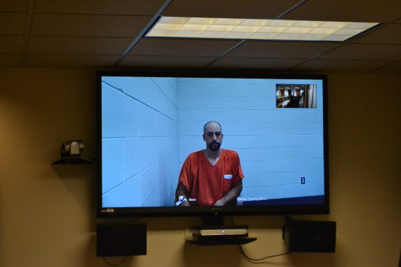 Matthew Lawrence Krueger, 33, of Illinois was arraigned via video conferencing from the Ottawa County Jail Wednesday, Feb. 11, in 78th District Court in Hart on four felony arson counts.