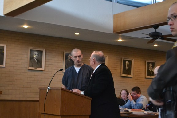Jay Jacob Ball consults with his attorney, Doug Springstead.
