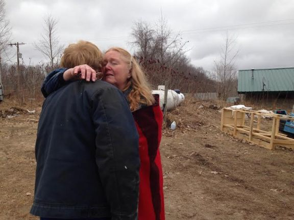 Verta Batch gets a hug from her brother, Earl Wurthner of Rothbury, after this afternoon's fire.