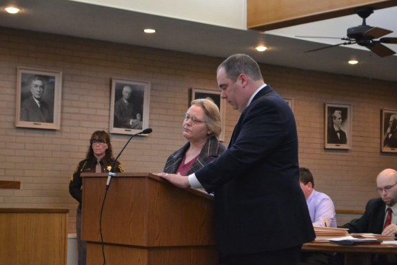 Judy Kumzi with her attorney Timothy Hayes.