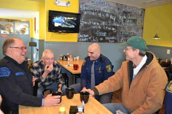 Michigan State Police Motor Carrier Officer Dan Roesler, at left, shares a laugh with Mears resident Gerald Morley, Trooper Doug Tanner and Hart resident Rick Aerts at the Golden Eatery in Mears Wednesday morning.