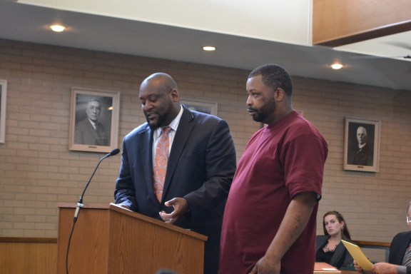 Kane Alray Burks, at right, with his attorney, Michael Oakes.
