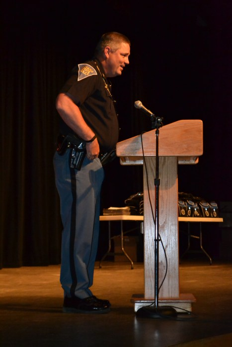 Sgt. Tony Slocum of the Indiana State Police address the audience at TEAM graduation at Hart Middle School Monday evening.