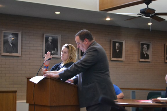 Jennifer Curtis pleads in 27th Circuit Court with her attorney, Tim Hayes.
