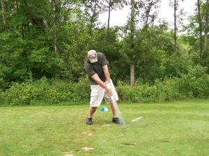 Jim Current of Shelby hits his tee shot on a par three in Sunday' s round of the Joe Foster Open.