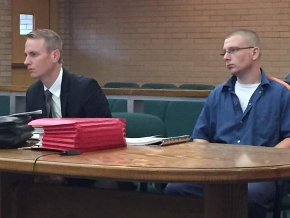 Foster Mudget with his attorney, Harold Emelander.