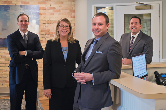 Matt Borgula, Kathy Springstead, Mike Bartish, and Gary Springstead (R-L) in their new office in Grand Rapids.