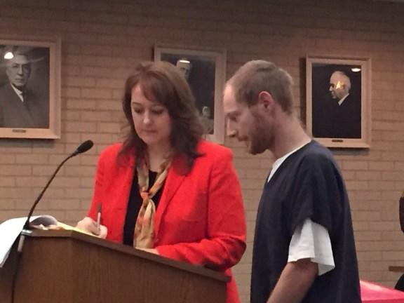 Justin Jobbins with his attorney, Julie Springstead Waltz.