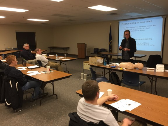 Stephen Alsum of the Grand Rapids Red Project trains law enforcement personnel on the use of Narcan.