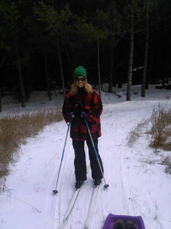 Cross country skiing is one of many outdoor activities OCP Editor Allison Scarbrough enjoys in Oceana County. Pictured here, she is wearing a hunting coat that belonged to her late father, William Scarbrough. Her dad taught her an appreciation for the simple things in life that Oceana County offers.