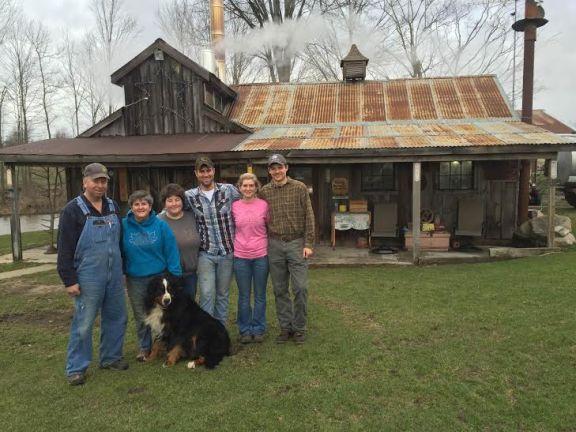 The Merten Family, left to right, Tom, Jill, Lindsey, Ethan, Whitney and Zack Hintz. Family pet Miles, a Bernese Mountain dog, center.