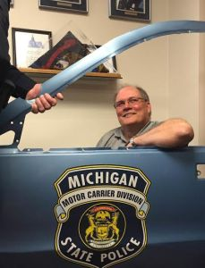 Roesler received a joke gift from his fellow officers -- a damaged door from an old motor carrier cruiser.