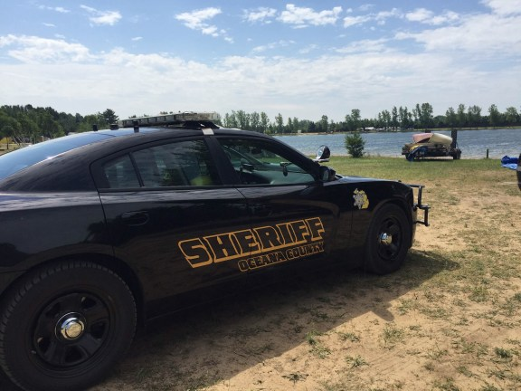 An Oceana County Sheriff's patrol car at the scene Monday morning.