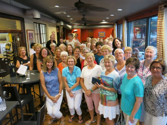 Lisa Baker (front row, at left), an Oceana County Medical Care Facility capital campaign cabinet member, is joined by her fellow Oceana Women Who Care members who met Sept. 6 and chose to have each of WWC's 145 members write $100 personal checks to the campaign.