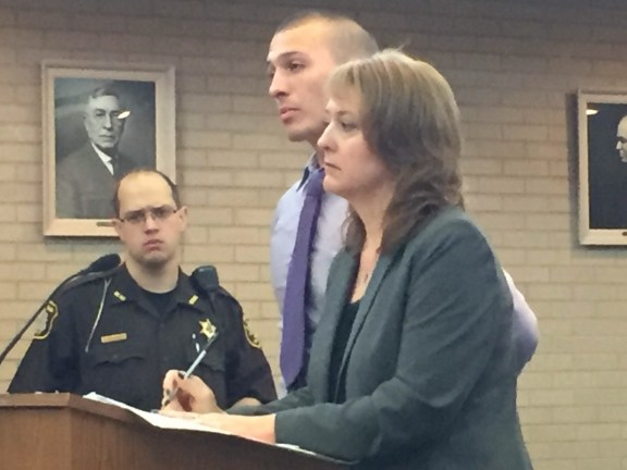 Gilberto Colon with his attorney, Julie Springstead Waltz. Deputy Dave Gregwer of the Oceana County Sheriff's Office is pictured in the background.