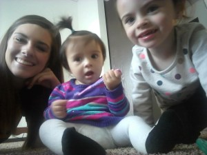 Becca Gallop with her two young daughters inside their apartment.