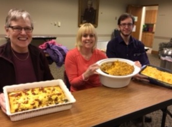 Kristina Cechura, (center) took first place in the Hesperia Community Library's macaroni and cheese cook-off. Dawn Haase took second place, and third place went to Justin Riley.