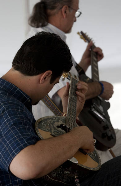 The sounds of the Golden Flame Band entertain diners during the 2010 Newport News Greek Festival Thursday. Shown playing the Bouzouki is George Barlas (foreground) and Tasos Christou on the electric guitar in the background.