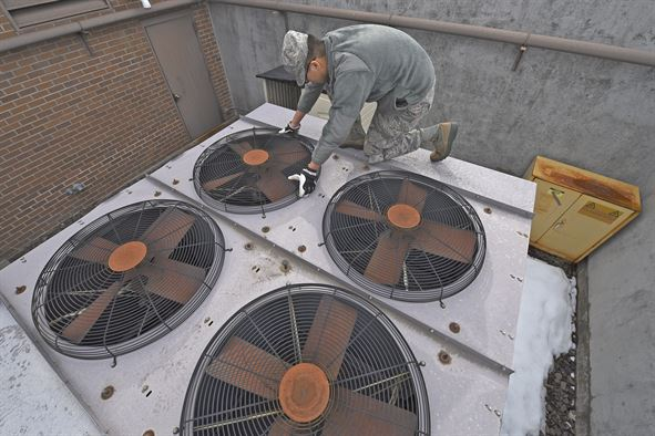 A soldier fixing air ventilation