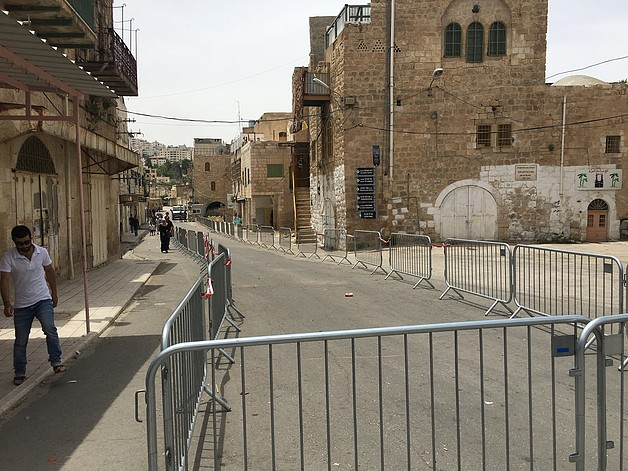 Barriers separating walking sides for Palestinians and Israeli settlers in Al Sahle street in H2.