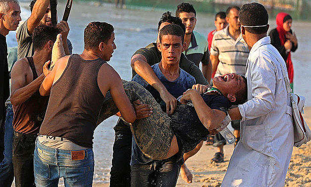 Palestinian injured during a demonstration protesting the naval blockade on the beach near the fence , northwest of Beit Lahiya. September 2018. Photo by Ashraf Amra