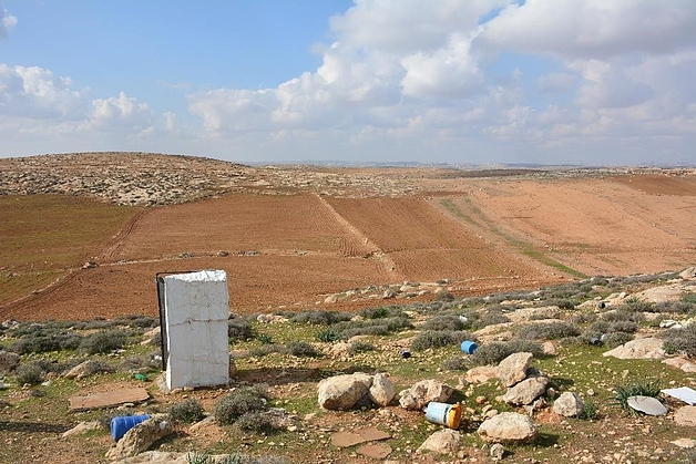 Rudimentary latrine with no water, only standing walls for privacy, located a few hundred metres from the nearest home in the Palestinian community of Khirbet ar Ratheem.