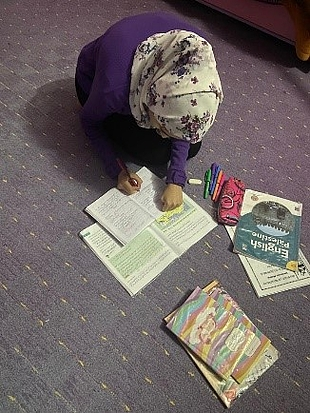 Rana successfully doing her home-work after receiving assistance.