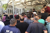 Farmers waiting at the entrance of Qalqiliya DCL to apply for 'Seam Zone' permits, 16 Sep 2020.