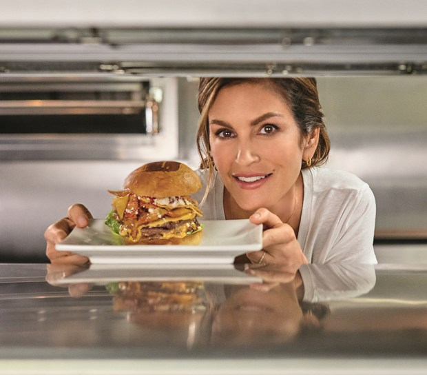 Cindy-Crawford-with-Cindy's-Casa-Burger-at-Umami-Burger
