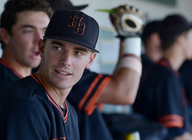 Huntington Beach's Hagen Danner talks with teammates before recent game. Danner will be one of five Orange County players who will be first round-draft picks in the MLB draft on June 12 (Photo by Bill Alkofer,Orange County Register/SCNG)