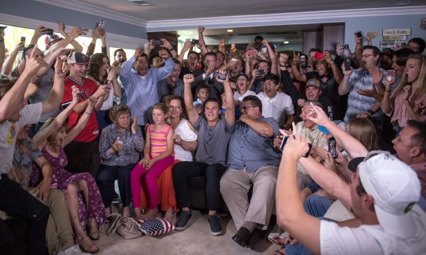 Huntington Beach High baseball player Nick Pratto and family and friends celebrate as Pratto is being selected by the Kansas City Royals in the first round, 14th pick during the MLB Draft Day at his girlfriend Chance Burden's House in Huntington Beach on Monday, June 12, 2017. (Photo by Kyusung Gong, Orange County Register/SCNG)