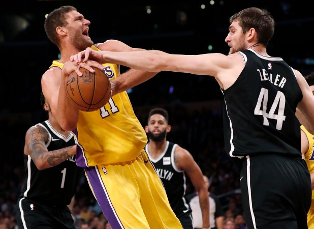 Brooklyn Nets center Tyler Zeller, right, goes for the ball as Los Angeles Lakers center Brook Lopez, left, yells during the first half of an NBA basketball game, Friday, Nov. 3, 2017, in Los Angeles. (AP Photo/Ryan Kang)
