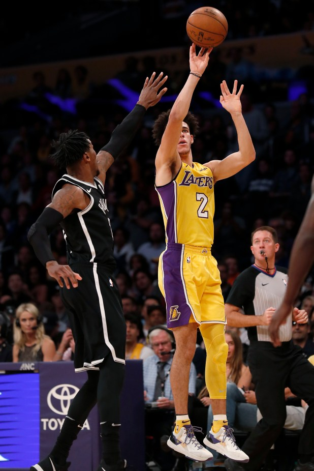 Los Angeles Lakers guard Lonzo Ball, right, shoots next to Brooklyn Nets forward Rondae Hollis-Jefferson during the first half of an NBA basketball game, Friday, Nov. 3, 2017, in Los Angeles. (AP Photo/Ryan Kang)